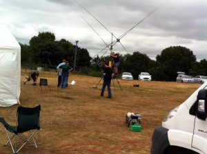 David G7UVW walks to lend a hand erecting Dave M0TAZ's 20m quad